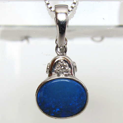 blue australian 18 karat gold boulder fire opal pendant with diamond crown