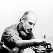 Lawrence Stoller at work in his studio cutting quartz crystals