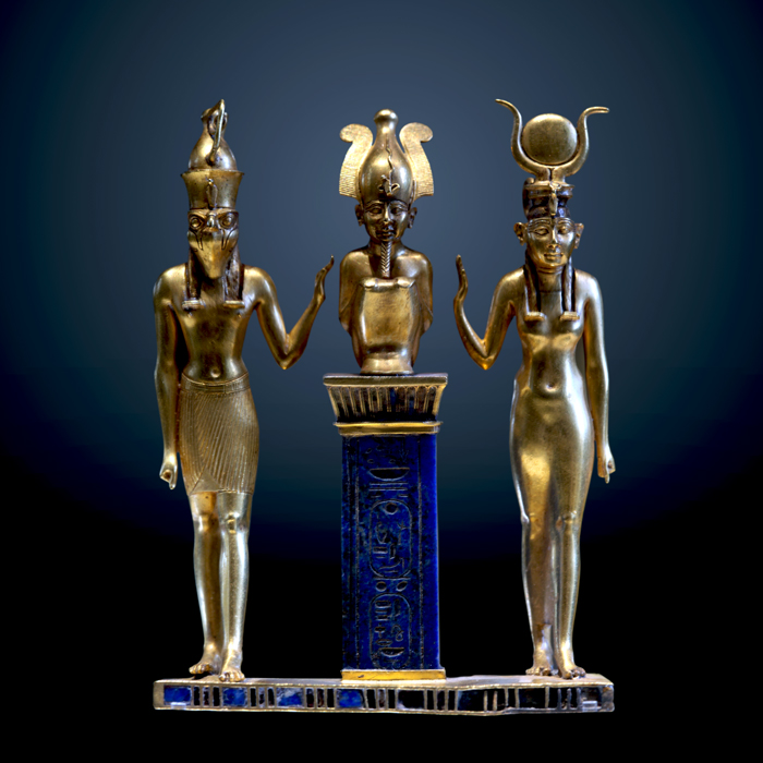 The family of Osiris. Osiris on a lapis lazuli pillar in the middle, flanked by Horus on the left and Isis on the right (22nd dynasty, Louvre, Paris)