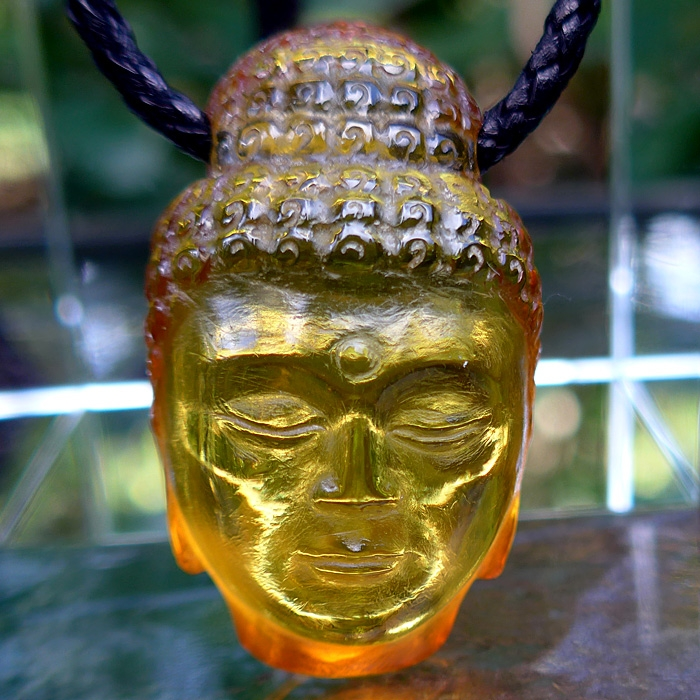 Hand Carved Amber Buddha Pendant by Pedro Michel
